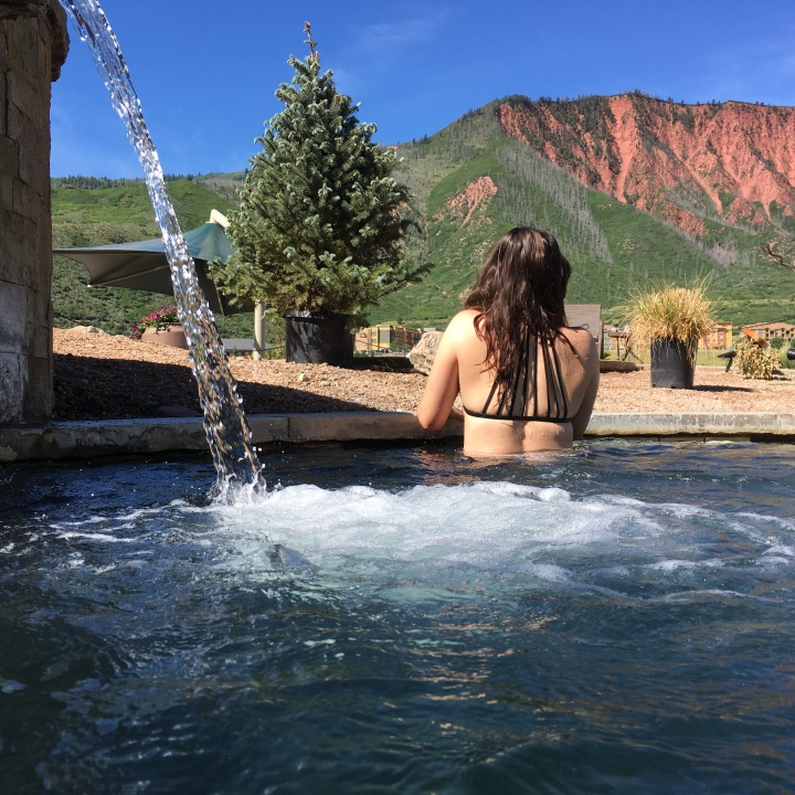 Gazing at the red mountains while soaking at Iron Mountain Hot Springs.