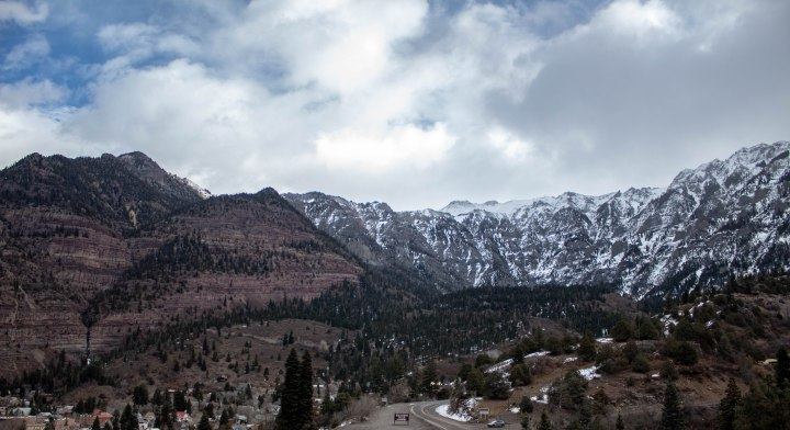 The view of the canyon walls and mountains that encompass the town of Ouray from the top of Box Canyon.