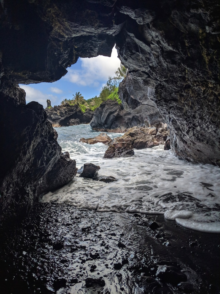 Peaking through a lava tube at Wai'anapanapa State Park.