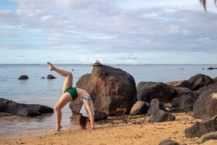 wheel pose on the beach