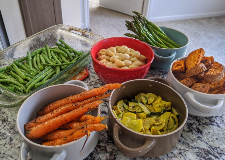 Roasted green beans, carrots and asparagus, sautéed zucchini and yellow squash, dairy-free mac and cheese, and baked sweet potatoes.
