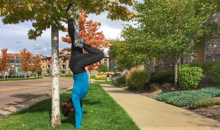 Practicing handstands outside.