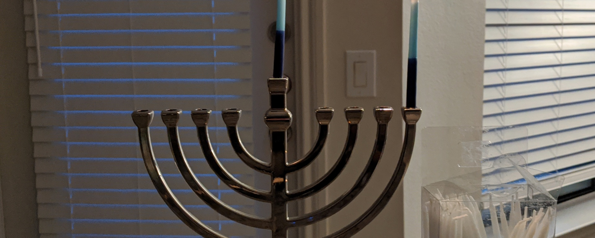 First-night-of-Hanukkah candles burning.