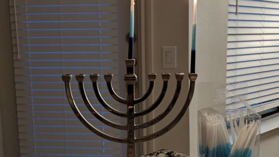 First-night-of-Hanukkah candles burning.