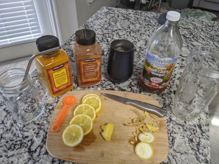 Ingredients include lemon, ginger, turmeric, cinnamon, brewed green tea, and apple cider vinegar.