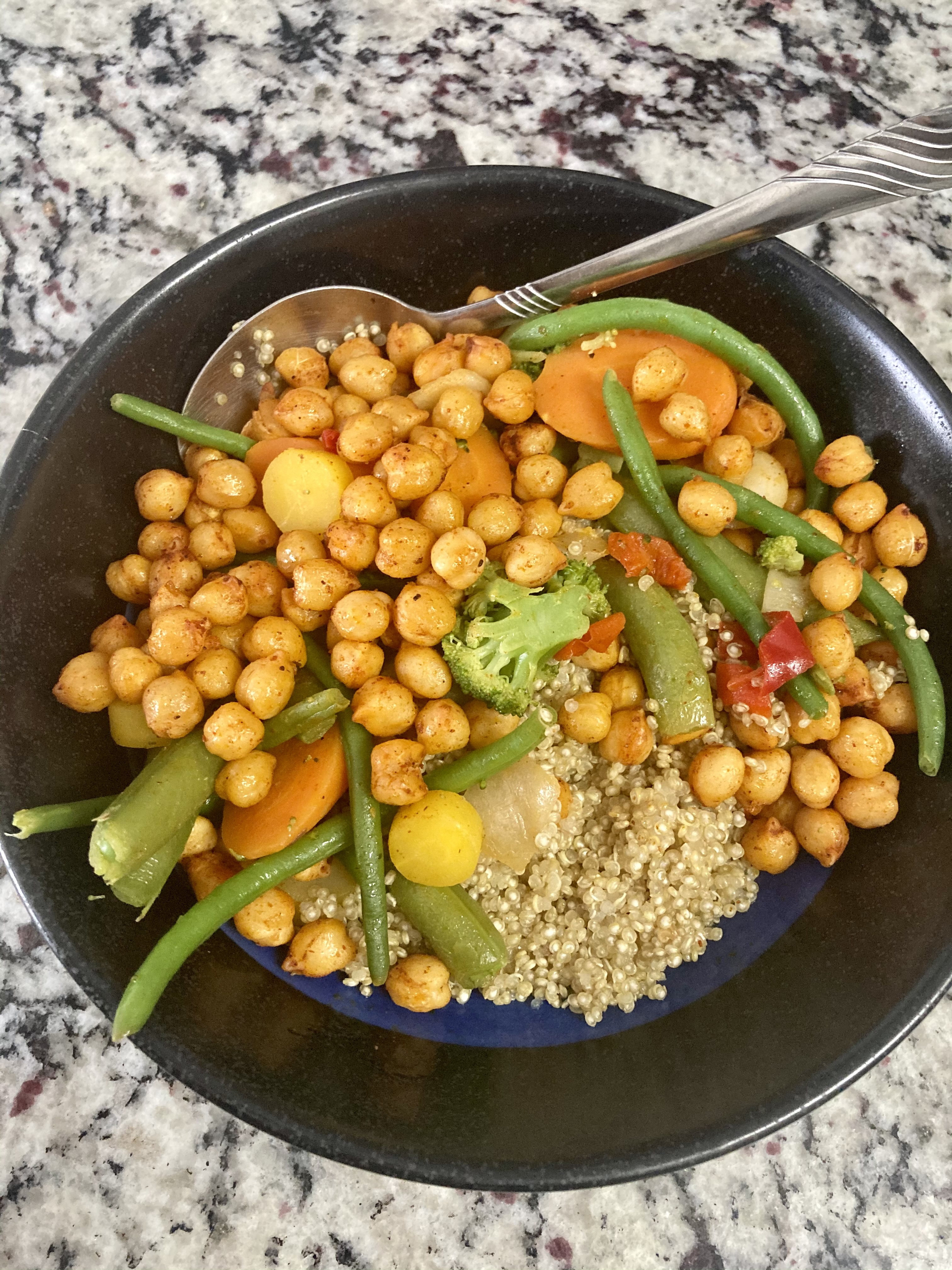 quinoa bowl with roasted chickpeas and veggies.